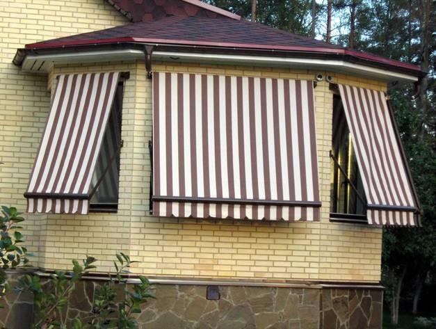 Вертикальные маркизы в виде навесов на окна